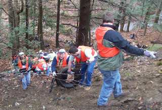 volunteers removing trash fro hillside